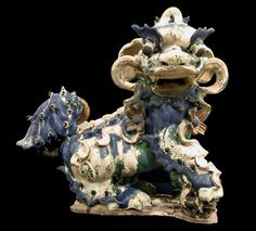 "Glazed terracotta sculpture of a Fu Dog, circa: 1368-1644 AD, Ming Dynasty.  The Fu Dog, or Fu Lion as it is also known, is a ubiquitous symbol that has been employed repeatedly throughout the history of China. Sometimes referred to as the ""Dog of Happiness"" or the ""Celestial Dog,"" the earliest traces of the Fu Dog in China date to the Han Dynasty (206 B.C.-220 A.D.). Then it disappeared from Chinese art until it was resurrected during the cultural revival experienced during the T'ang…"