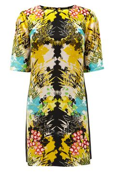 This stunning t-shirt dress injects a burst of colour to your winter pieces. The mirrored print will be on the top of the list for any fashionista. Make a wardrobe investment. Complete with black tights and boots in the winter or add sky-high heels for the evening! (length approximately 85cm/33.5inches UK size 10).