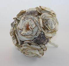 Handcut, handmade bridal bouquet of vintage music sheets and silk flower blooms. Feature of brooches and diamantés. Www.tamaraharrison.com.au