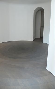 TWIRLED (2010) represents one of Raphael Navot's early explorations in flooring art. This piece finds its home in a Paris apartment and is built out of a series of rings – each one turned 5% clockwise to create a gentle vortex effect.