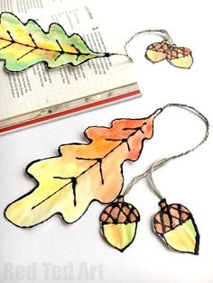 Watercolour Leaf Bookmarks - these leaf bookmarks look fabulous and are easy to make. Use our free oak leaf printables to make these black glue and watercolour leaves and turn them into fabulous watercolour leaf bookmarks for Autumn. Such a beautiful Autu