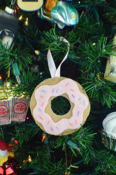 """This DIY donut ornament is so easy to make for any donut-lover! Make in a variety of """"flavors"""" and give out as sweet gifts for Christmas."""