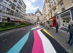 Lang-Baumann, Street Painting #7, 2013, 59 x 3,8 m, road marking paint. Rennes (France). Produced by 40mcube and PHAKT, in partnership with Signature and Identic, and with the support of the City of Rennes and the Swiss Art Concil Pro Hevetia. Courtesy Loevenbruck gallery and Urs Meile gallery. Photo : Lang-Baumann.