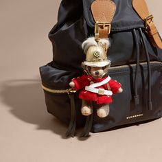 A charm featuring Thomas Bear, our signature teddy, in soft check cashmere with a regimental uniform.