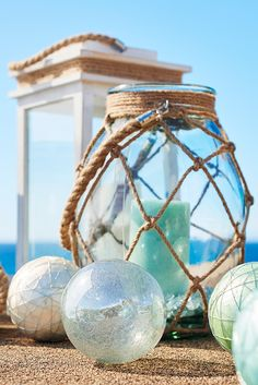 Feeling nautical? Pier 1 had this handcrafted clear glass lantern tied up in knots just for you. The natural rope accents lend a cottage accent that we think is just beachy.