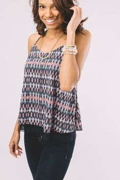 Layered racer-back tank with a sassy cut out back. Pair with black jeans and heels for girls night.  Details - Color: Navy - 100% Polyester - Hand wash...