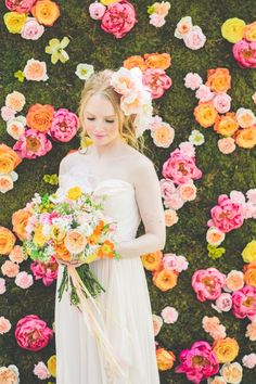 talk about a floral backdrop! filled with peonies and roses, this is one stunning background for a wedding canopy or a photo spot | Photo by Paper Antler