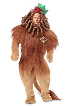 The Wizard of Oz Cowardly Lion Doll - BarbieCollector - Designed by: Lauri Sipos  --   Before he receives a medal of courage from the Wizard, the Cowardly Lion™ must face his fears on a journey through the Land of Oz. With curly brown faux fur and a tiny red bow atop his head, the doll is sculpted in the likeness of Bert Lahr, the actor who portrayed the Cowardly Lion in the film.