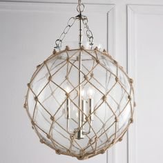 Rope Net Glass Sphere Chandelier Knot your average chandelier! Rope in a lattice net pattern wraps a clear glass globe with chrome shackles and chain and a cluster of 3 lights inside for a nautical necessity.