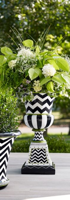 Our Zoey Urn is an update to the classic Roman urn with a dynamic, hand-painted design and a finish that mimics glazed ceramic.