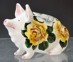 Unusual wemyss pig with yellow and white cabbage roses