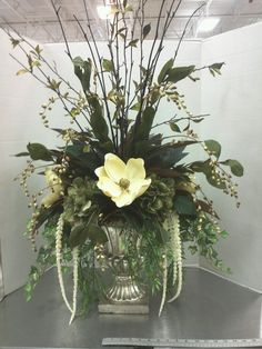 Magnolia and lots of greenery in an urn