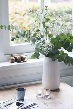 Baby's breath & Eucalyptus in a vase. 100% PURE Inspired Ingredient: Eucalyptus