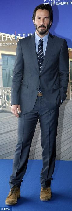 Just one pair?: Keanu has shown up in multiple suits but with the same pair of distressed ...