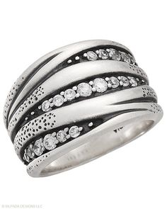 Gleaming Cubic Zirconia collect atop this Sterling Silver Ring that shimmers with abundant sparkle. Whole sizes 5-11.