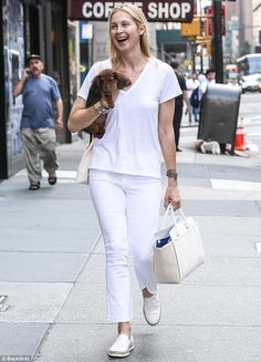 A bit of all white: Kelly Rutherford looked marvelous makeup free in New York on Tuesday
