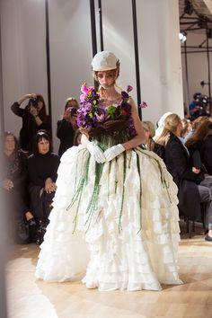 The bride wears her bouquet backstage at Yohji Yamamoto SS15 PFW. More images here: http://www.dazeddigital.com/fashion/article/21964/1/yohji-yamamoto-ss15