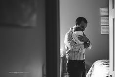 black-and-white-photo-of-dad-holding-swaddled-newborn-by-Beth-Ann-Fricker-840x561.jpg