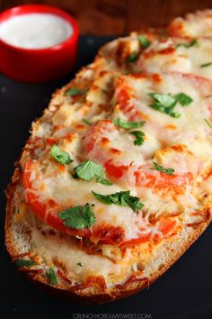 Italian Chicken Cheesy Bread - easy cheesy bread that quickly becomes a meal, all thanks to grilled chicken, sweet red pepper sauce, tomatoes and lots of cheese!