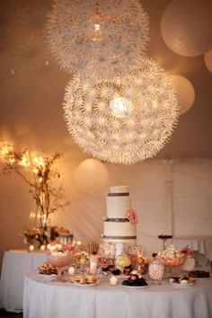 Love these chandeliers that look like dandelion seed heads! They add brightness and light to the decor.