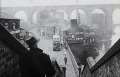 Lowry sketching Stockport Viaduct from the Wellington Bridge steps, Stockport, 1962