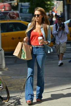Celebrity street-style : Jessica Alba in Flare Denim, bold colour top and denim chambray shirt