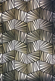 Berkeley Wallpaper A semi reflective Art Deco style wallpaper with a geometric pattern in silver.