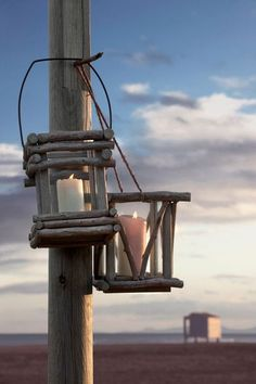DIY Rustic Driftwood Lanterns ..super easy to make + beachy coastal home decor + garden
