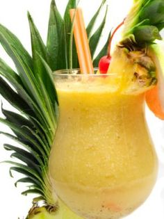 Cayman Sunset Tropical Drink...Cayman Sunset Tropical Drink...amber rum, dark rum, banana liqueur, pineapple juice, orange juice, piña colada mix, Myer's Rum floater