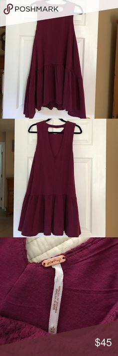 Free People maroon Dress XS BRAND NEW Free People maroon dress without tags but NEVER WORN. Soft material and great color. Free People sizes always run a little big so it would definetly fit a small. Free People Dresses