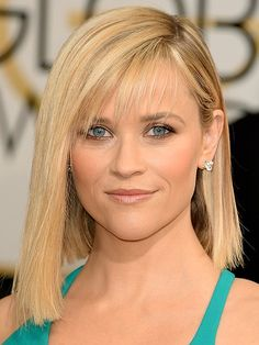 A blunt bob doesn't have to mean equally blunt bangs. Reese Witherspoon's light-as-air bangs are a soft, modern contrast to her geometric bob.
