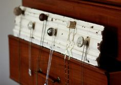 Necklace Display. Practical, pretty, and a good use for the cute knobs I see in stores :)