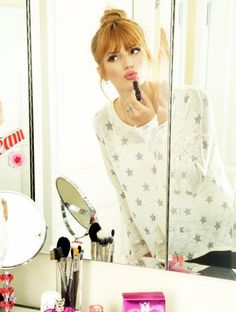 bella thorne... She's sort of obnoxious but I love her hair makeup and style!!