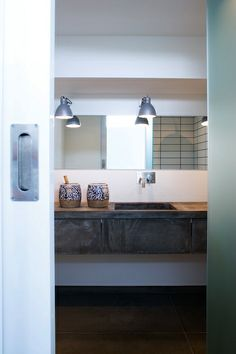 Like the concrete poured look to this floating vanity