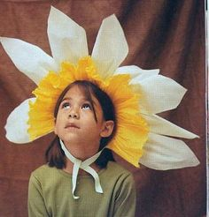 Crepe Paper Flower http://nursery.apartmenttherapy.com/images/uploads/2007-10-31-crepe%2520paper%2520costume.jpg