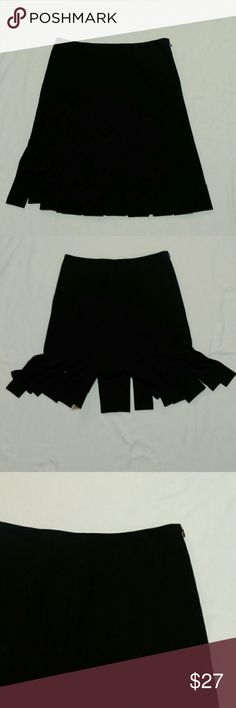 Classy black flappy skirt Very flattering, trendy skirt. Side zip. Skirt measures 13.75 inches from waist to slits. From slits to the bottom measures 7 inches. Waist is approximately 28 inches. Not brand new with tags, but is in excellent condition. White House Black Market Skirts