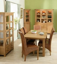 A beautiful dining set. An antique oak finish extending table complimented with real tan leather chairs. Full range of occasional pieces to match available.