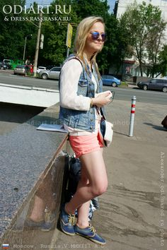 Street fashion in Moscow. Pink hot pants. Girl in pink hot pants and denim vest. Alexander odigif@gmail.com Author's photo from Russia.