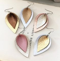 ~~ These gorgeous new spring metallics are much more vibrant in person! ~~ If you dont own a pair of dreamy, lightweight leather earrings, you are missing out! Various colors, patterns, sizes and shapes are available for any fashionista. See links below for more choices. FYI...The