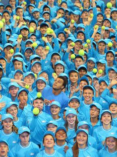 2013 Australian Open Previews    Jo-Wilfried Tsonga of France poses with the squad of 380 Australian Open 2013 ballkids at the National Tennis Centre ahead of the 2013 Australian Open at Melbourne Park on January 8, 2013 in Melbourne, Australia.    The squad includes 20 ballkids from Korea, 6 from China and 23 from interstate.    Photo by Scott Barbour/Getty Images