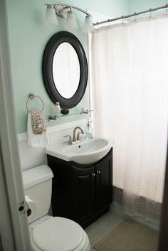 I really like the colors and how airy it is. Makes such a small bathroom look bigger. I think all three of us girls could agree on this style for the upstairs bathroom.