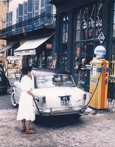 Woman filling her Fiat up in Paris, 1954