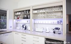 Kitchen design ideas - a large benchtop pantry / appliance cupboard for easy access to your items while you work.
