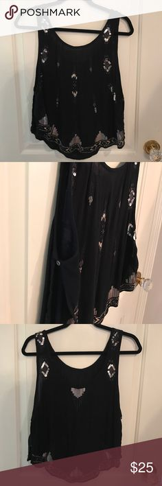 FREE PEOPLE EMBELLISHED TANK Free people perfect condition tank, no missing embellished pieces. Black with silver embellishment. It's a show stopper and the perfect and sexy night out tank. Free People Tops Tank Tops