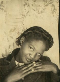 Photo booth portrait of an African American woman | by oakenroad