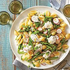 Pasta Shells with Spring Vegetables | Pea tendrils, the tender tips of pea vines that taste just like the peas, make an unexpected and charming garnish.