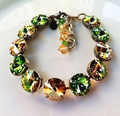 New Swarovski Rivoli Golden by HisJewelsCreations on Etsy, $48.00