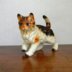 Grandma loved cats and she had a collection of kittens. They were divided up and given to her grandchildren when she passed away. Being a cat lover too, I was given a few of her cat figurine treasures,