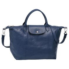 108157d151c Discover the world of Longchamp and the latest collections