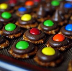 Put a Hershey's kiss on a pretzel and put them in the microwave. Then push a m&m in them when done. Cute easy snack for a party.